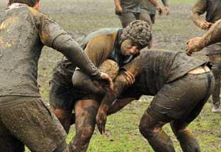 Muddy marvels: Old Walcountians hooker Matt Houghton on the charge against Farnham during his side's 15-12 victory in atrocious conditions  Alun Stockton