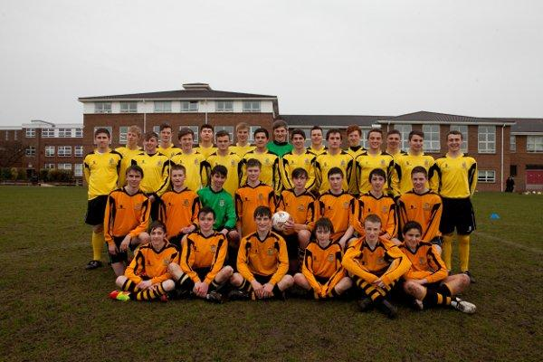 Seeing double: Hampton Schools U18 footballers, in yellow, line up with their U15 schoolmates