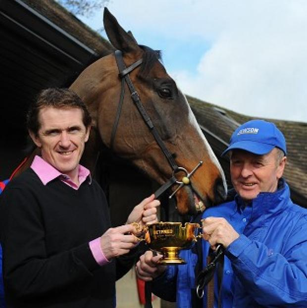Cheltenham Gold Cup winning jockey Tony McCoy (left) and trainer Jonjo O'Neill (right) with winning horse Synchronised