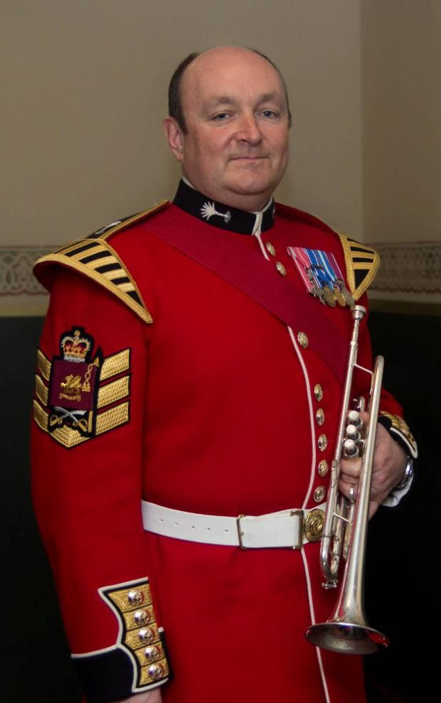 Welsh Guard band member Adrian Beckett appears on the charity CD