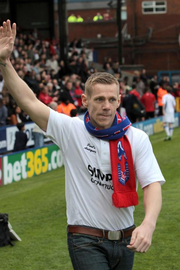 Ready for battle: Chas Symonds salutes the Palace crowd last Saturday