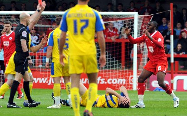 Croydon Guardian: Nightmare: Jason Prior lies injured with a double leg break as Crawley Town's Hope Akpan is sent off for the challenge that caused it. Courtesy: Liz Finlayson