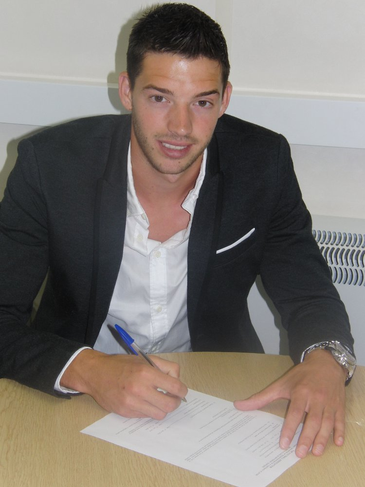 Signing on the dotted line: Aaron Martin. Picture: Crystal Palace Football Club