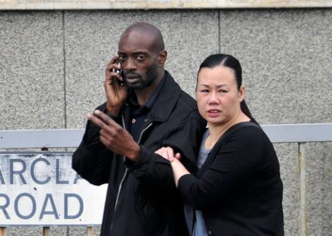 Derek Hoilett and Shan Shan Su leave court