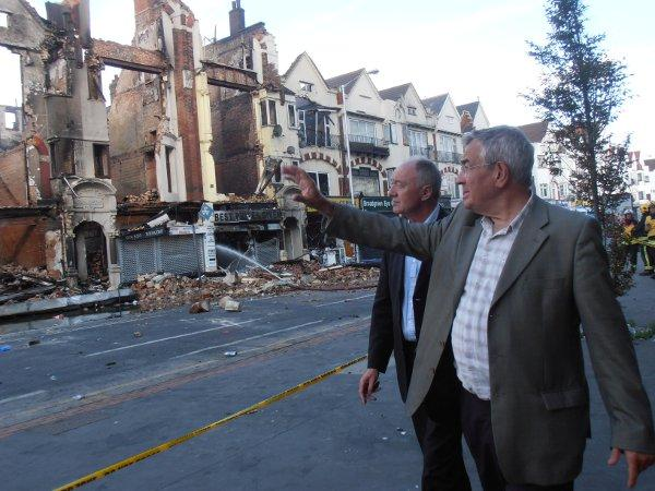 MP Malcolm Wicks surveys the damage of the riots