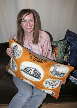 Ellie Laycock with the Croydon cushion