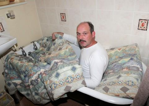 Roger Ellis was forced to sleep in the bath in his New Addington home