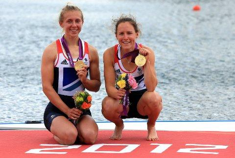 Golden girls: Kat Copeland and Sophie Hisking celebrate gold at Eton Dorney last week  Picture: PA Wire/Stephen Pond