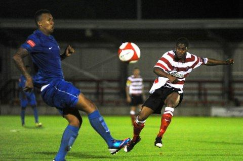 Croydon Guardian: Andre McCollin: the striker starts a three-match suspension this weekend
