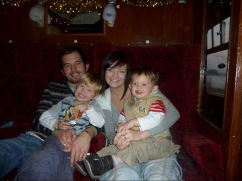 Leanne Curtis-Cobb with her husband Stuart and sons Josh and Finn