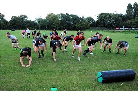 Putting their backs into it: Weybridge Vandals are put through their paces during pre-season training 	SP69710