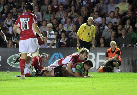 Debut delight: Former Quins youngster Seb Jewell clings to Ben Botica as he scores in last Friday's 4