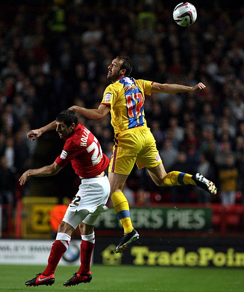 Glenn Murray beats Danny Hollands to a header