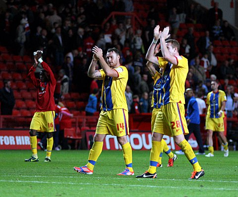 Croydon Guardian: Crystal Palace players celebrate victory with their fans on the final whistle