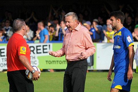 Red rage: Terry Brown vents his anger at the referee in red during the Dons' 2-1 defeat to Rochdale on Saturday    SP68731