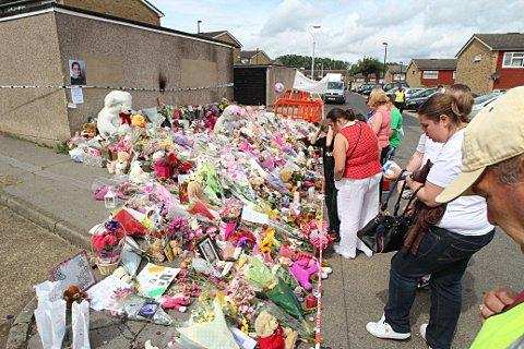 Hundres left floral tributes in The Lindens where Tia was found dead