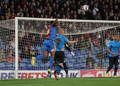 Kagisho Dikgacoi's looping header puts Palace in front