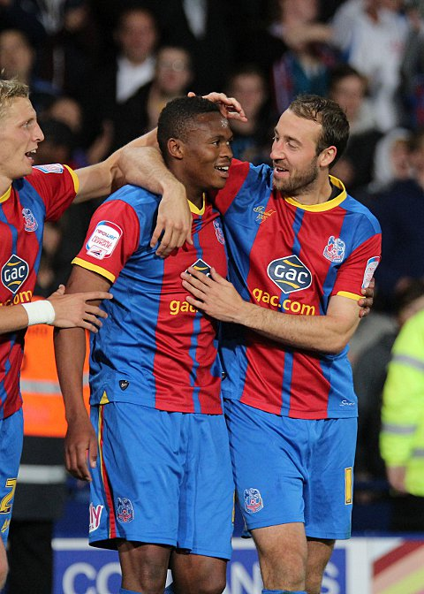 Dikgacoi is congratulated by Dean Moxey and Glenn Murray
