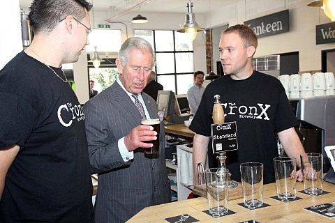 Prince Charles has a taste of Cronx standard with brewers Simon Dale and Mark Russell