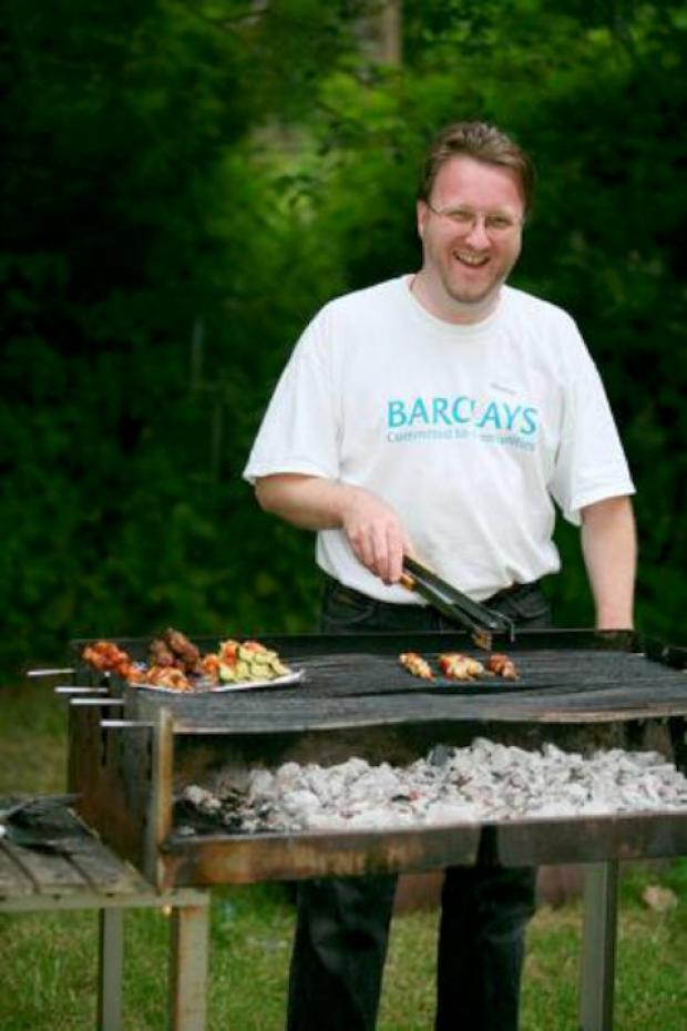 Martin Donnelly man's the bbq at Courtwood Primary's leavers event