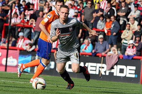 On target: Brentford's Adam Forshaw - playing in silver to mark the 25th anniversary of the Brentford Community Sports Trust - struck to give the Bees three points on Saturday
