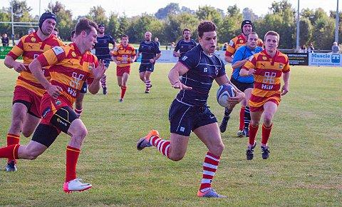 On the run: Charlie Broughton races for the line in the National League One win over Cambridge
