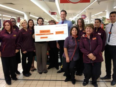 Sanisbury's staff with cheque for Home-Start Croydon