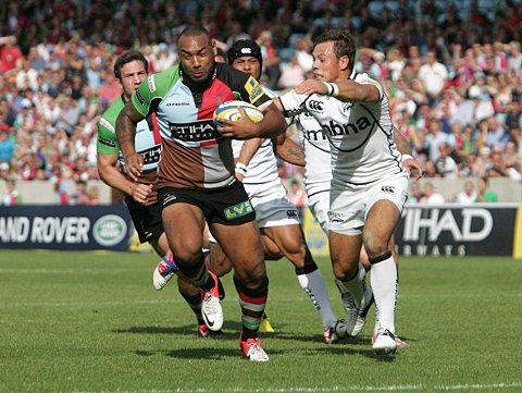 Bulldozer: Quins centre Jordan Turner-Hall charges to the line against Sale Sharks last week