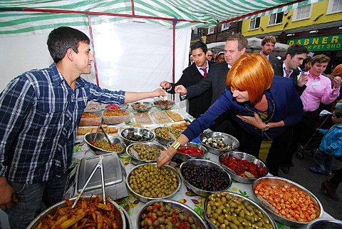 Kez Hassan (far left), Paul Collins (middle) - both from the Town Team, and Mary Portas try some olives on Surrey Street Market.