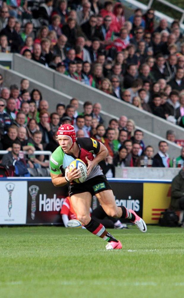 Croydon Guardian: Determined: Quins cente Matt Hopper was up against it in Sunday's war of attrition with Saracens