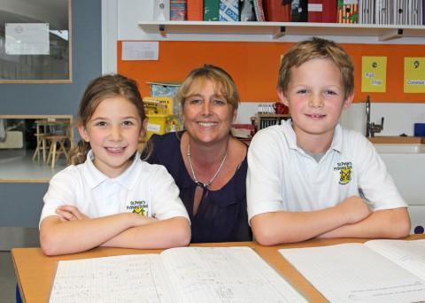 Caroline Barriball with two of her former pupils Ellie Thomas & Harry Daykin (both 8)
