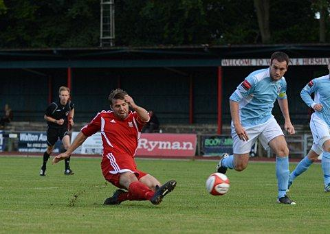Good effort: Swans striker Graeme Purdy slots home his chance on Saturday