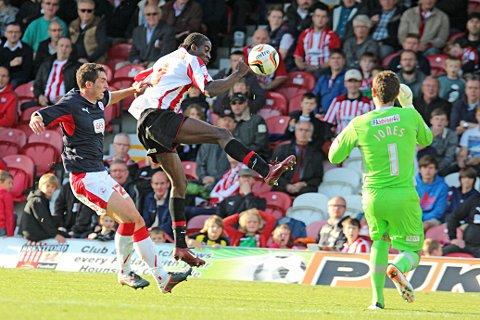 Croydon Guardian: First to the ball: Clayton Donaldson flicks the ball past Crawley keeper Paul Jones for Saturday's winner
