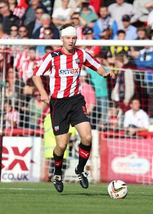 Own goal: Tony Craig's late own goal cost the Bees three points at Griffin Park on Saturday