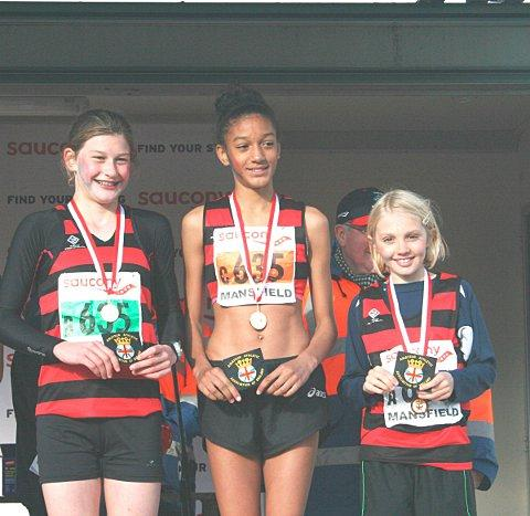 Terrific trio: Saskia Millard, Katy Ann McDonald and Alex Brown parade their medals after winning the Saucony National cross-country relays title for Herne Hill Harriers