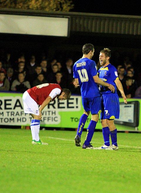 Agony and ecstasy: Jack Midson and Stacy Long celebrate Dons' fourth goal against York City      SP71719