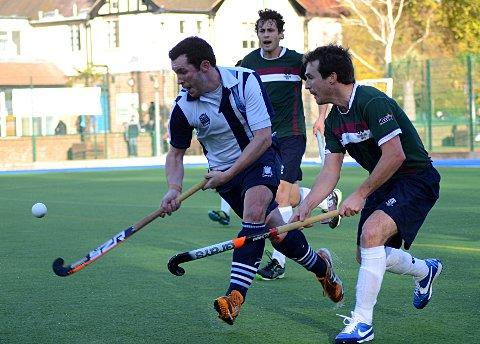On the ball: Surbiton's Tim Pinnock, left, in action against Hampstead & Westminster  Picture: Tim Reder