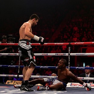Carl Froch, left, knocks down Yusaf Mack at the Capital FM Arena