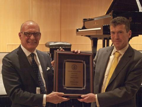 Craig Terry presented a plaque to Headmaster Mark Bishop