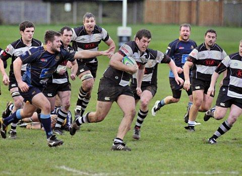 On the charge: Peter Matthews shows the team determination to get through the Guildford back line   SP72888