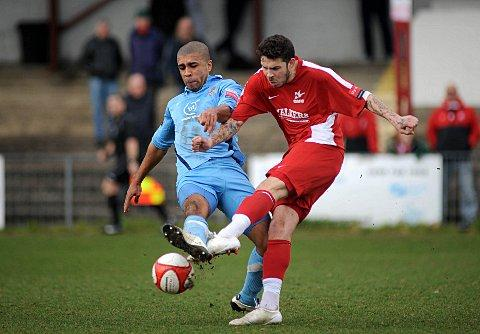 Return of the King-stonian: Former Carshalton striker Paul Vines tussles with ex-Ks midfielder Bashiru Alimi at Colston Avenue last season