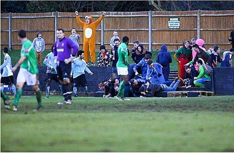 Croydon Guardian: Front of the terracing collapses as Dulwich Hamlet supporters celebrate. Photo: Neil Hood