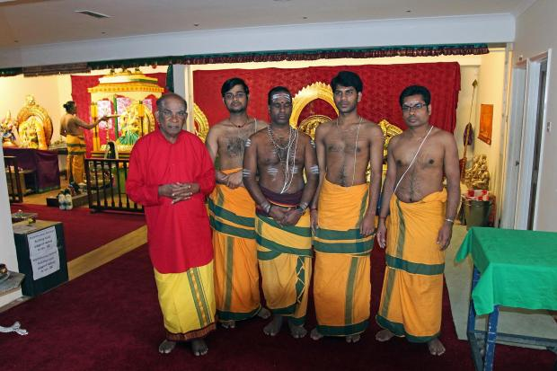 Temple founder Nagendrum Seevaratnam with hindu priests