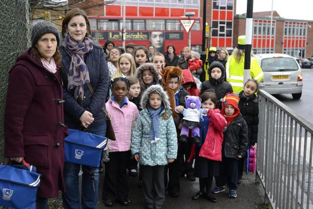 Parents and children at Blackhorse Lane, which stands to lose its lollypop lady under council plans