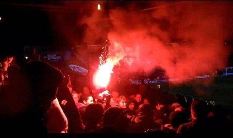 A flare is set off in the away end