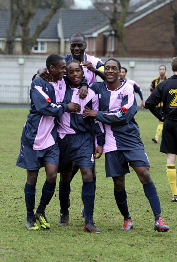 Croydon Guardian: Celebrate good times: Xavier Vidal is mobbed after scoring for Hamlet against Dulwich    SP72946