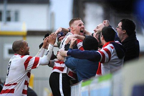 Goal rush: Kingstonian midfielder Lewis Taylor celebrates with fans at Kingsmeadow