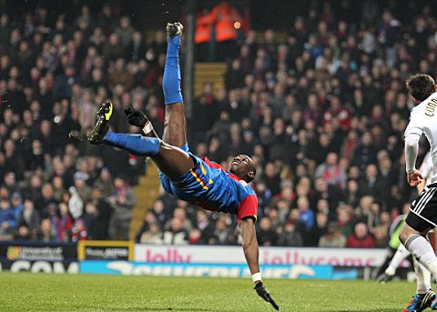 Croydon Guardian: Yannick Bolasie tries a stunning overhead kick which hit the woodwork
