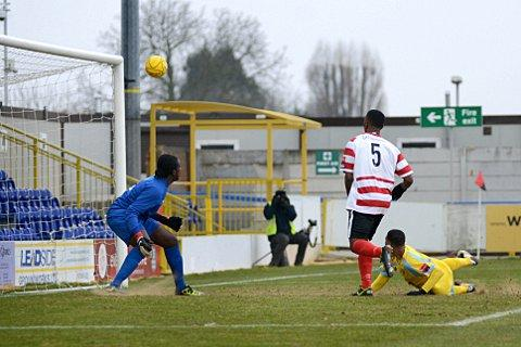 Close: Ian Gayle just fails to test the Canvey Island keeper in the 2-1 defeat at Kingsmeadow on Saturday    SP72984