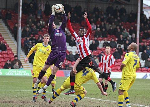 Flyer: Brentford's Bradley Wright-Phillips challenges Walsall keeper Aaron McCarey 	SP73020